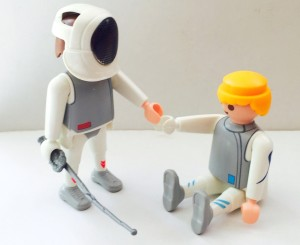 Fencer helps another fencer that is injuired during the fencing bout (LEGO fencers figurines)