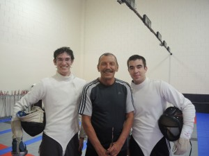 Fencing coach Alexander Maximovich with his students Chase Hauser and Dylan Black
