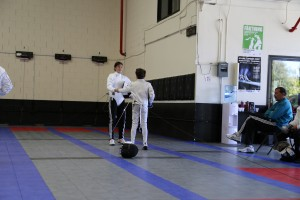 Fencing hand shake is important ritual of traditional fencing etiquette