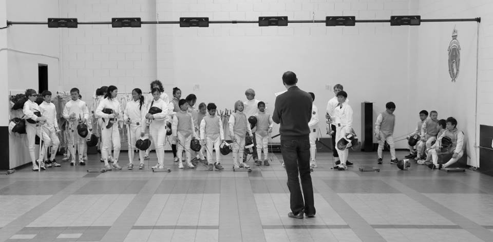 Head of Bout Committee makes an announcement to fencers about tournament